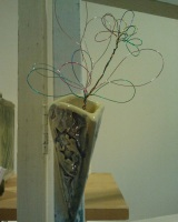 Wall vase with wire flowers
