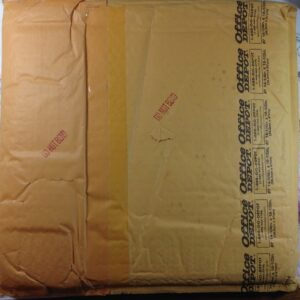 Backside of package still taped up